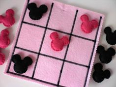 Mickey Mouse tic-tac-toe. Use black and red instead of pink. Yellow board.
