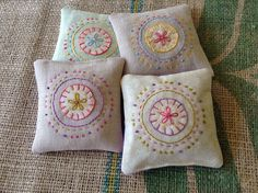 embroidered sachets filled with lavender, chamomile, flax seed, and rosemary, by Bonnie Sennott