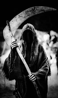 Grim Reaper. I saw him once as a young girl while visiting an old cemetery. It was a sunny, summer day. He didn't have a weapon but was pointing to get out. Man, did we run!