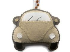 This gorgeous VW Beetle Plush Toy is perfect for all VW Bug / Love Bug / Herbie fans!    It is made from wool blend felt and filled with polyester