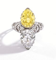 3.57ct fancyintenseyellow and 3.59ct pear-shaped diamond ring by Tiffany& Co. circa 1905