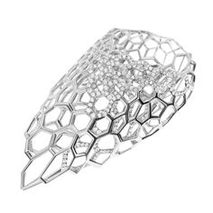 Zaha Hadid's first collection of gold jewellery, designed for Caspita, was unveiled yesterday at the architect's London Gallery.