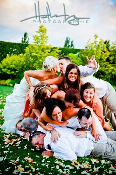 Dog Pile wedding party ... only after the ceremony...I love this! The groom is like wait.. Wait a minute. I have to kiss her
