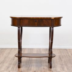 This antique side table is featured in a solid wood with a mahogany finish. This end table has dovetailed joinery, a second-tier shelf, and intricately carved legs. Perfect for the living room! #victorian #tables #endtable #sandiegovintage #vintagefurniture