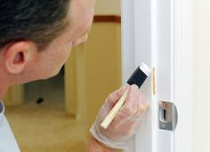Touch up any problem spots or scuffs with paint before putting your house on the market.