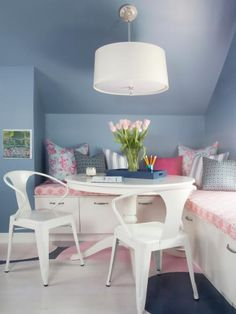 HGTV has a teen's dream room with a window seat with custom pink cushions, graphic multicolor pillows, white regency table, white pendant light and cool chairs. Design Blog, Portfolio Design, Design Styles, Design Ideas, Dining Room Sets, Pantone Azul, Window Seat Storage, Bench Storage, Attic Storage