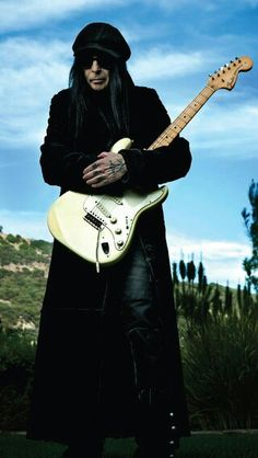 Mick Mars. Awesome picture. He is such an amazing inspirational person.