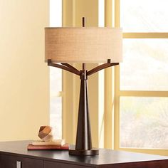 The burlap fabric lamp shade balances wonderfully with the bronze finish, creating the rich beauty of this traditional table lamp.