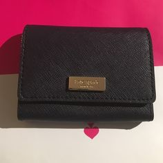 NWOT Kate Spade Card Holder This is a black Kate Spade card holder with a snap front. This is brand-new, and has never been used. Offers are welcome. ❌No trades!❌ kate spade Bags Wallets
