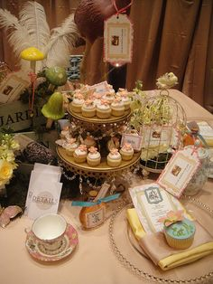 Alice in Wonderland themed table setting and desserts, via Flickr.