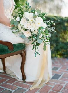 White, ivory + cream flowers with greenery | Photography: The Ganeys
