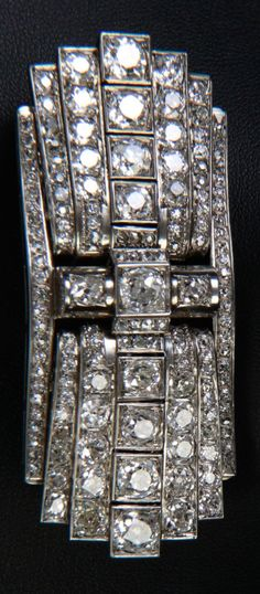 Attributed to Dusausoy - An Art Deco steel and diamond double-clip brooch. 7 x 3cm. #Dusausoy #ArtDeco