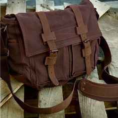 Mix style and utility! Get this large canvas and leather messenger bag for school with buckled magnetic snaps and comfy shoulder straps for only $69.99!