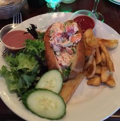 Lobster roll sandwich. This was delicious! That vinaigrette dressing was astounding! I enjoyed this meal with a glass of Pellegrini Vineyards Merlot which was also delicious and also pth! to expected pairing.   Tina and I just love CJ's American Grill in Mattituck