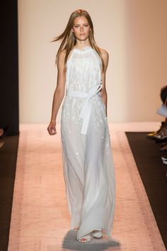 Wedding Dresses for the Fashion Obsessed: Beach-loving brides, this halter-neck-style gown by BCBG Max Azria was made for a casual, cozy seaside affair.