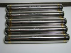 Stainless steel cigar tubes engraved in script style - hard to photograph, but very popular groomsmen gifts!