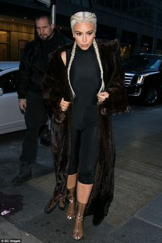 Here comes Mrs. West! Kim Kardashian stepped out in New York City on Saturday sporting a pair of perspex boots from her husband Kanye West's Yeezy Season 3 collection