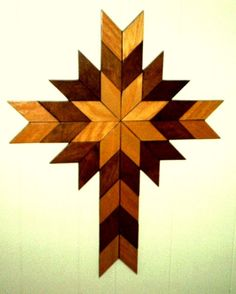 A beautiful wall cross, for you or perhaps your favorite Pastor or Clergy-person. Each small square is cut, sanded and stained pryer to instillation. Can be made as shown or in color combinations of your choice. Pricing (dependent on woods used) to come.