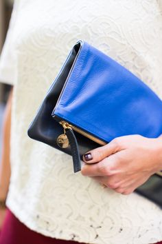 Clare Vivier's fold-over leather clutches are a great way to add pops of color and texture to any look. | Click to shop.