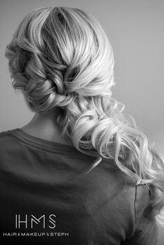 Lovely half undo. Looks part braid/part twist