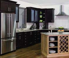 Java kitchen cabinets set against stainless steel appliances creates a clean sophisticated look. Homecrest Cabinets, Appliance Garage, Contemporary Style, Modern, Stainless Steel Appliances, Java, Kitchen Cabinets, Corner, Table
