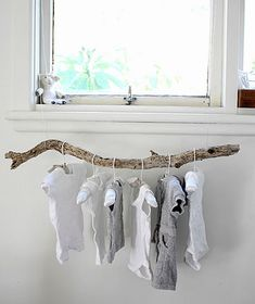 How about adding a driftwood rod instead of an ugly metal rod to hang your clothes - fun idea!  Laundry or babies room