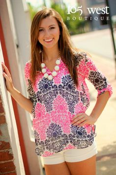 "The ""Coral Reef"" Blouse in Pink and Navy $36.50. Comes in S,M,L. Available at 105 West Boutique in Abbeville, SC. (864)366-9378. Shipping $5. Follow us on Facebook and Instagram!!"