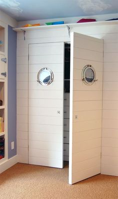 Porthole mirrors on a closet for a nautical room