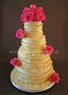 White Chocolate Wrap Wedding Cake - maybe with Gerbera Daisies instead of roses..