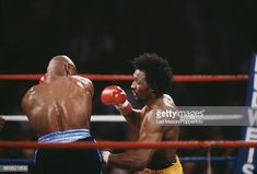 American boxer Marvelous Marvin Hagler pictured left in dark shorts in action against fellow American boxer Thomas Hearns in yellow shorts in a fight. Marvelous Marvin Hagler, American Boxer, Yellow Shorts, Leo, Wrestling, Dark, Boxing, Pictures, Action