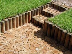 cross sections of wood as a paver or stepping pads.  Also like the idea of the wood stumps as a retaining wall.  We could possibly get the stumps from a local tree company for free.
