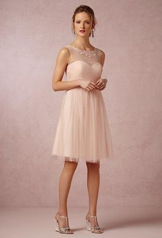 A short blush bridesmaid dress with an embellished illusion neckline | @jennyyoo | Brides.com