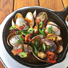 Michael's Genuine Food & Drink Wood Oven Roasted Manilla Clams with chorizo, tomato broth topped with scallions 🍅🍖🍲😛