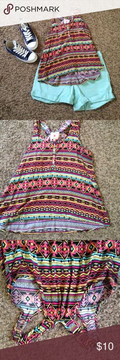 🎉🎉 LAST CHANCE/FINAL PRICE 🎉🎉 BUNDLE AND SAVE! This is an adorable top. My daughter loved it so much. Still in great condition. Soft. Washes well. Great, bright tribal print. A little longer in the back. Four shell buttons down the front. Racer back. Size L  it says to hand wash but we've only machine washed and it looks great. Pink Republic Tops Blouses