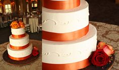 White Wedding Cake with Orange Ribbon and Roses
