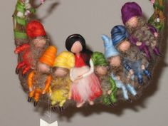 Snow White and seven dwarfs...interesting idea to create a felted necklace...