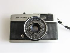 OLYMPUS TRIP 35 CAMERA & Olympus D. Zuiko 1:2.8 40mm LENS made in Japan Just listed starting at only £11.95 (!) Bargain