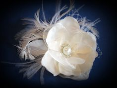 Bridal Flower Hair Wedding Clip Fascinator Ivory Flower with feathers and Russian veil. $35.95, via Etsy.