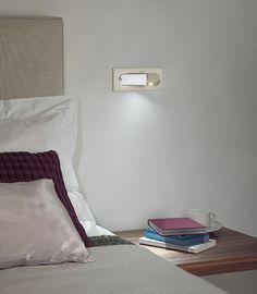 Funky neat little bedside light....simply folds away when not in use !