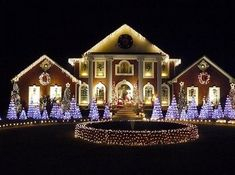 beautiful light display on large mansion night lights outdoors house decorate display christmas - Christmas House Decorations