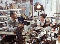 size: Premium Photographic Print: Designers Charles Eames and Wife Ray Eames Filming Toy Trains at Their Studio by Allan Grant : Artists Charles Eames, Ray Charles, Model Trains, Toy Trains, Legos, Converse, Train Layouts, Classic Toys, Old Toys