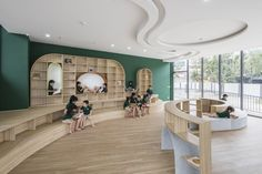 All the furniture is custom built from plywood. #dwell #designnews #vietname #kindergarten Learning Environments, Learning Spaces, Window Frame Colours, Activity Based Learning, Circular Buildings, Education And Development, Outdoor Playground, Water Element, Interior Design Companies