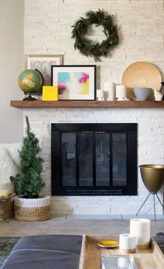 Rustic modern fireplace makeover using Glacier stone ledger from Floor + Decor | homeologymodernvintage