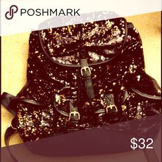 Gold & black sequin backpack Gold & Black sequin backpack has not been used Guess Bags Backpacks