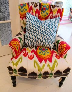 In LOVE!!! I love everything about this chair! Bright jewel tones and a bold print...what more could a chair ask for? Do not care too much for the pillow, it takes away from the visual impact of the chair.
