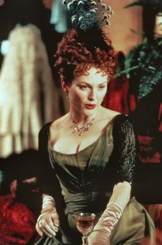 Julianne Moore as Mrs. Laura Cheveley in An Ideal Husband (1999).