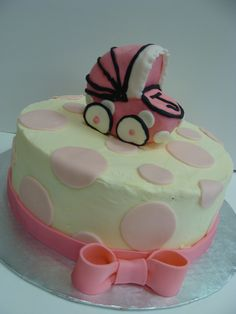 Baby Shower cake with rice crispy stroller.