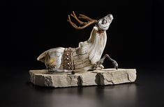 Artist: Shelley Muzylowski Allen Title: Following The White Hart Process: blown and free-hand sculpted glass, limestone Size: 18 x 28 x 11 Inches Year: 2016 Please contact the gallery for pricing  Habatat Galleries 248.554.0590 – info@habatat.com