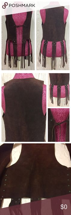 "Vintage Suede Leather Western Boho Fringed Vest Excellent condition! Never worn. Dark chocolate brown color. There is no stamp or tag in this, but feel, weight and smell is of suede Leather. Probably custom made for someone. Tacks might be brass since some have a light green tarnish....but you really have to look to notice. Mannequin is a size small. May be closer to a medium. Approx Measurements: P2P 17"". Arm opening 9"" length of Vest 18"" length of fringe 14"". This is a gorgeous piece and a…"