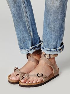 Blending style with comfort, Birkenstock's Yara sandals are coveted by women across the globe. Crafted from stone-colored suede with an adjustable ankle strap and toe loop, this pair features a classic footbed with a shock-absorbent EVA sole. Designed to flex as you move, these sandals are a vacation essential.